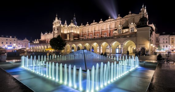 Fountain and Cloth hall (Polish: Sukiennice) during the night in Krakow, Poland